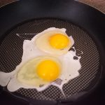 cracked-eggs-in-pan