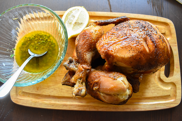 roast chicken on cutting board
