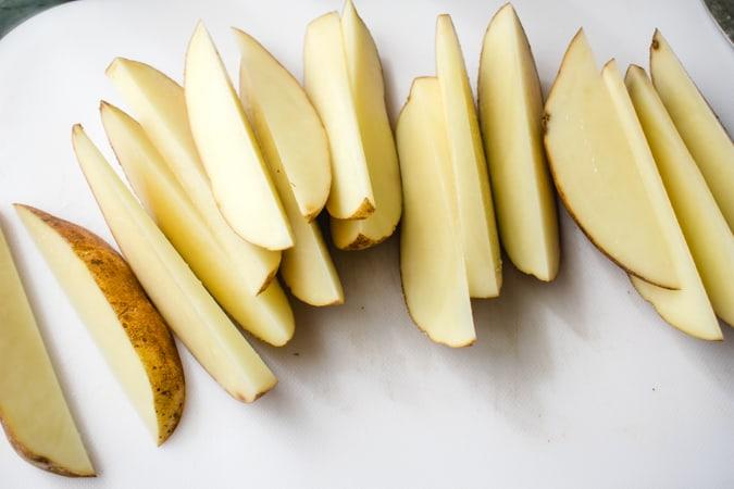 russet potato cut into wedges