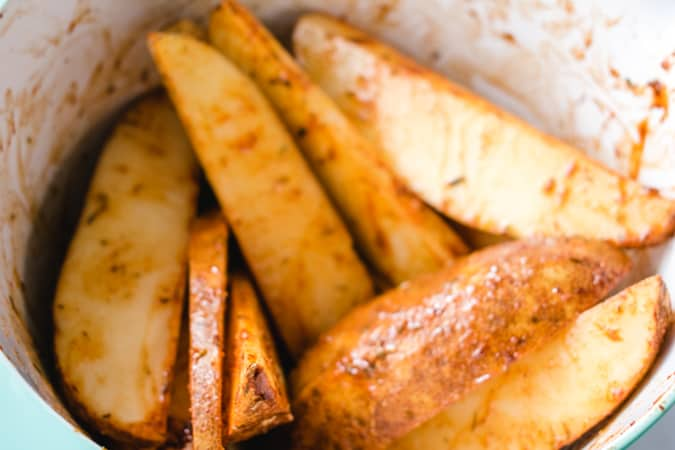 potato wedges mixed with spices